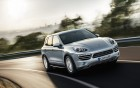Porsche Cayenne - front side view - luxury car with driver